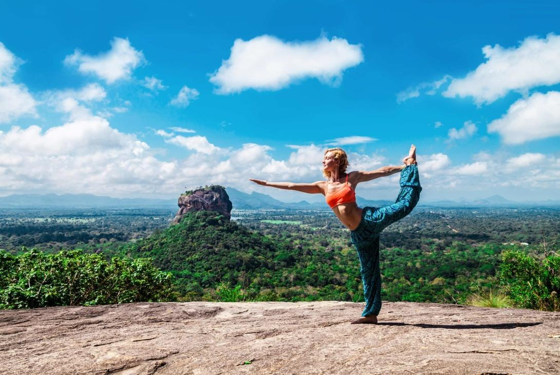 Girl practices yoga in the mountains of Sri Lanka